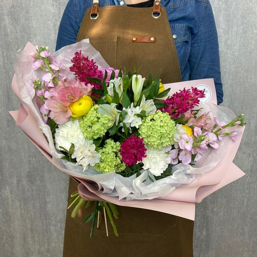 Author's bouquet with matiolla, hyacinth, daffodil, pistachio, ranunculus