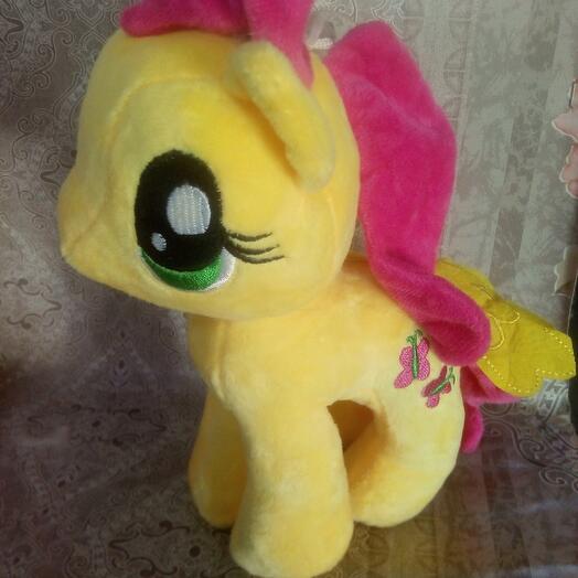 Пони желтая
