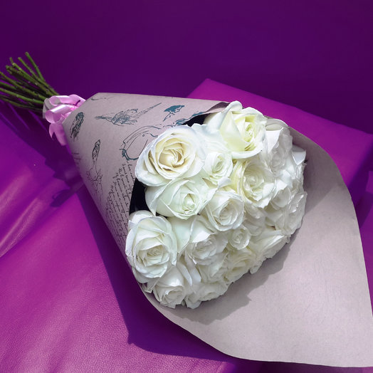 A bouquet of 23 white roses