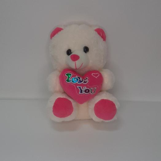 Soft toy bear with a heart