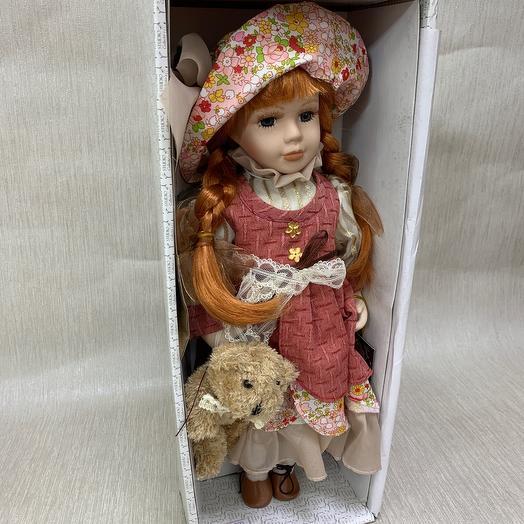 Куколка  в яркой шляпе