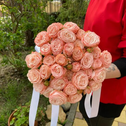 Bouquet of bush peony roses in an envelope