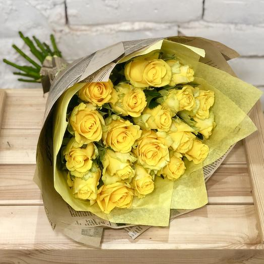 Bouquet of yellow roses in Kraft