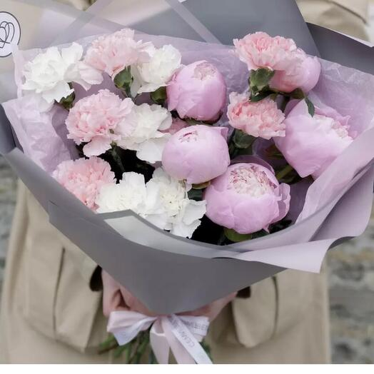 Peonies and delicate fashionable carnations