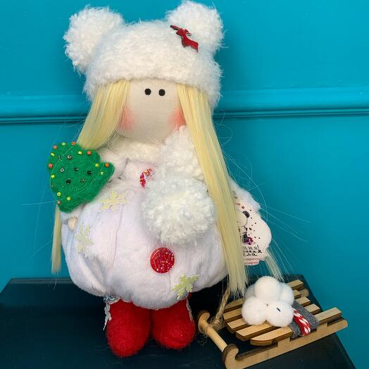 Author's doll with a sled and a Christmas tree