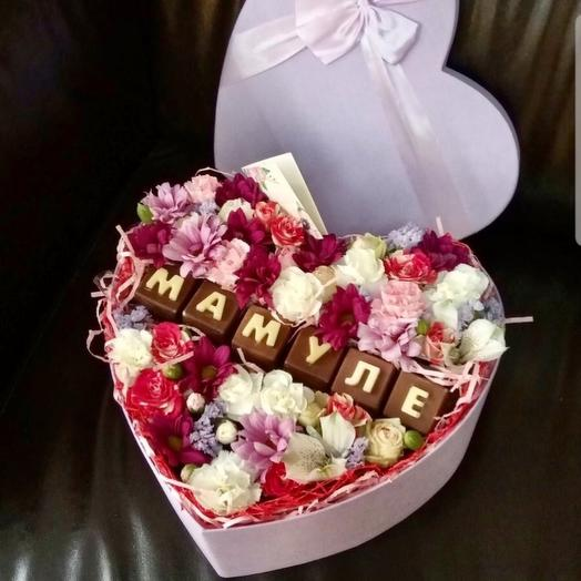 Flowers in a box with handmade chocolate
