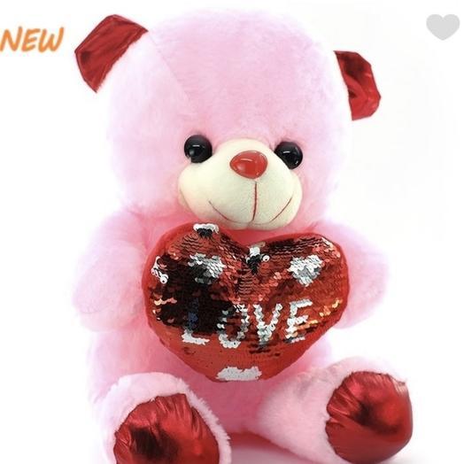 A bear with a shiny heart