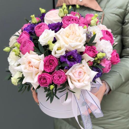 Composition of shrub and single-headed peony roses and eustoma Temptation