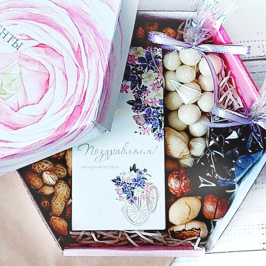 Gift set with tea nuts and sweets