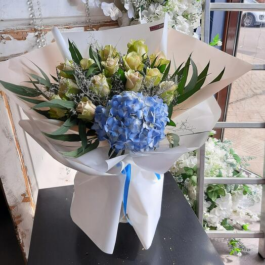 Pink bouquet with blue hydrangea