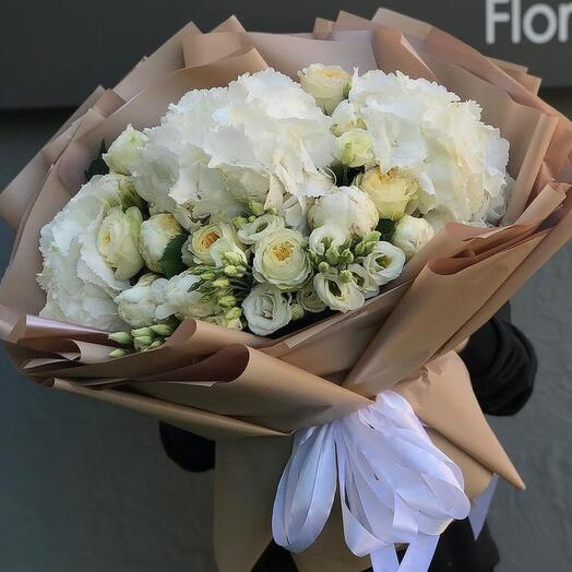 Large bouquet with peony-shaped roses, hydrangeas , eustoms , peony in craft