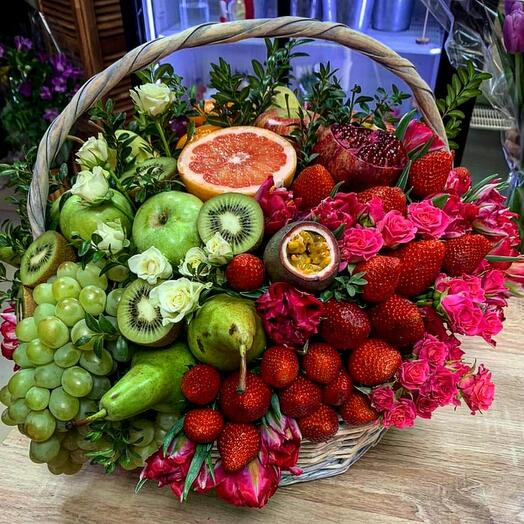 Basket with flowers and fruits