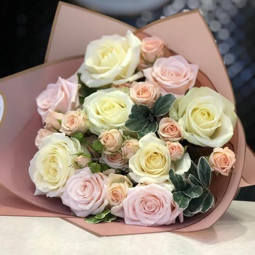 A prefabricated bouquet of single and spray roses