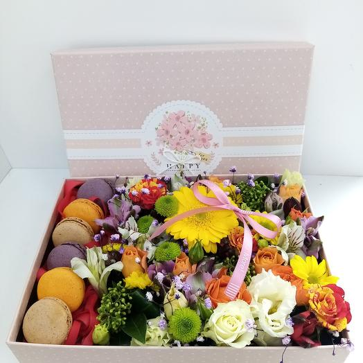 Flowers in a box with macaroons