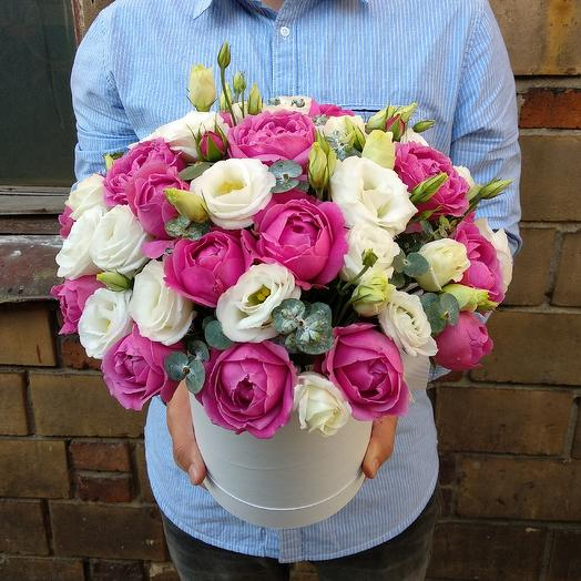 Peony roses, eustoma and eucalyptus in a box