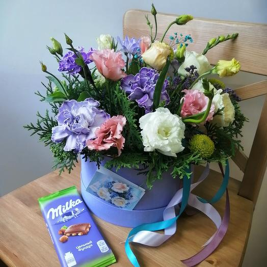 Box with fresh flowers and milk chocolate