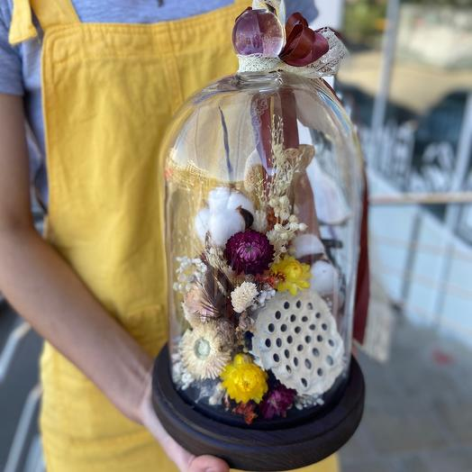 Dried flowers in a glass flask