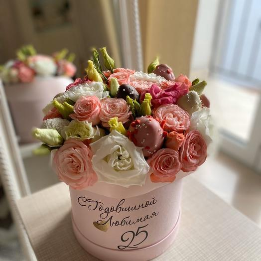 Delicate bouquet with flowers and chocolate
