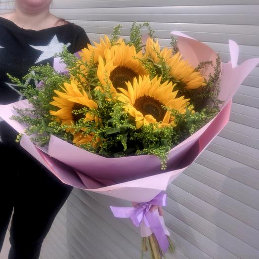 Bright bouquet of Helianthus (decorative sunflowers) with Solidago greens in a stylish designer package